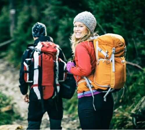 Two women hiking to illustrate benefits of Phreesia's Care Pathways for multi-specialty app