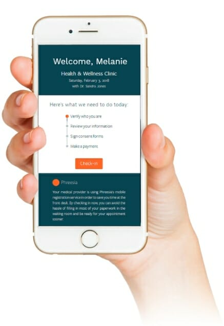 Woman holding her mobile phone displaying the Phreesia urgent care Patient Registration screen